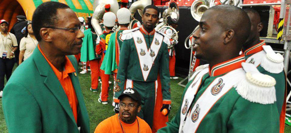 FAMU president James Ammons (left) greets Robert Champion (right) at the Atlanta Classic football game. (photo courtesy of the Rattler Nation blog)